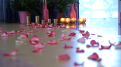 Lots of rose petals are straggled on parquet floor Stock Footage