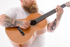 Fat man playing musical instrument Stock Photos