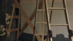 Metal stepladder stands in empty room which is prepared for reconstruction Stock Footage