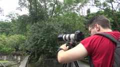 Caucasian Photographer takes pictures with DSLR camera-Dan Stock Footage