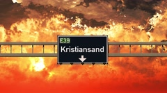 4K Passing Kristiansand Norway Highway Sign in the Sunset Stock Footage