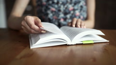 Female college student with book in library Stock Footage