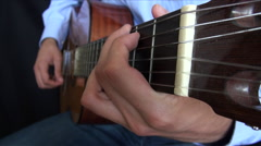 Close up of man playing classical guitar Stock Footage