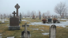Misty winter graveyard with crosses. Perth, Ontario, Canada. Stock Footage