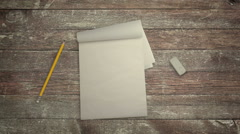 Notebook Pencil and Eraser in Stop Motion - stock footage