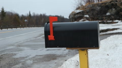 Mailbox on rural winter road. Car goes by. Ontario, Canada. Stock Footage