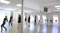 Girls in black clothes turn over to mirror one by one Stock Footage