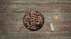 Full Ashtray with Cigarettes Buds with Lighter and Matches on Table in Stop Moti - stock footage