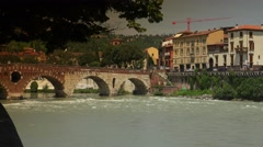 Adige river with Ponte Pietra (Stone Bridge) in Verona, ULTRA HD 4k, real time Stock Footage