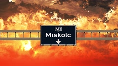 4K Passing Miskolc Hungary Highway Sign in the Sunset Stock Footage