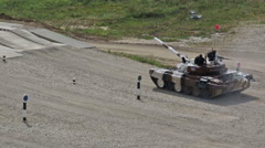 Tank biathlon. The Azerbaijani team at the finish on the T-72 tank Stock Footage