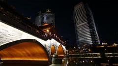 Night view of beautiful Anshun Bridge above Jinjiang river Stock Footage