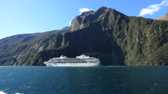 New Zealand Milford Sound cruise ship beyond Stock Footage