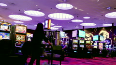 Motion of worker selling drink and people playing slot machine Stock Footage