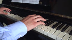 Hands of young man learning to play the piano Stock Footage