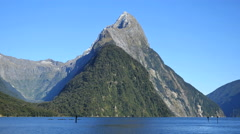 New Zealand Milford Sound Mitre Peak with kayaks Stock Footage