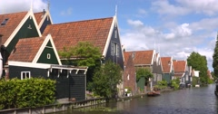 Traditional houses in 17th century village alongside canal Stock Footage