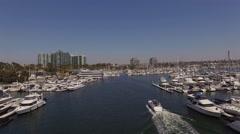 Aerial yacht sails along the Marina Del Rey California Stock Footage