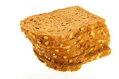 Wholemeal slices of bread Stock Photos