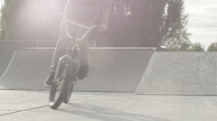 Bmx Bike Rider Performing Tricks In Skate Park At Sunset Stock Footage