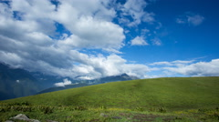 4k timelapse of fast moving clouds above beautiful high mountain grassland, with Stock Footage