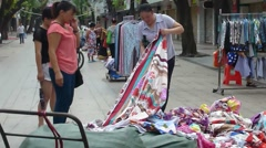 Roadside stalls selling quilt, in the streets of Shenzhen Stock Footage