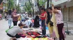 Roadside stalls selling cheap clothing - stock footage
