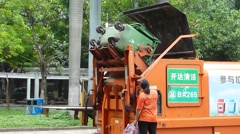 Garbage transfer station, workers are loading and unloading garbage Stock Footage