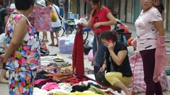 Roadside stalls selling cheap clothing Stock Footage