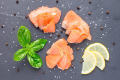 Smoked salmon filet with lemon and basil, top view, horizontal Stock Photos