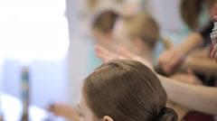 Girls prepare for photoshoot in art studio in makeup room Stock Footage