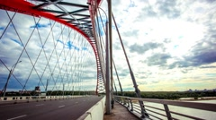Time lapse of road through the bridge with blue sky background with clouds of a Stock Footage