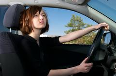 Attractive young female driving car Stock Photos