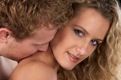 Love. He kiss her neck Stock Photos