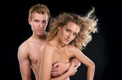 Beautiful naked couple with curly hair Stock Photos