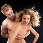 Beautiful naked couple with curly hair - stock photo