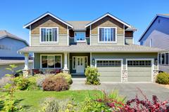 Curb appeal of luxury family house with nice landscape. Northwest, USA Stock Photos