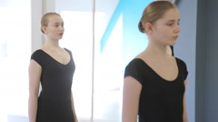 Young girls stand in stance before start of ballet lesson Stock Footage