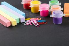 Colorful crayons and gouache Stock Photos