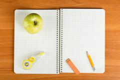 Open notebook with stationery Stock Photos