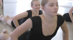 In model school young and beautiful women are lifting from the floor - stock footage