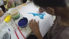 Young man practices water color painting Stock Footage