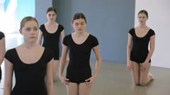 In model school young and beautiful females are standing on knees Stock Footage