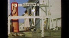 1952: Mathews Tackle trophy tarpon fish hanging women admires. PORT ARANSAS, Stock Footage