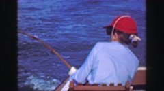 1952: Woman ocean charter fishing trip holding rod on boating adventure. PORT Stock Footage