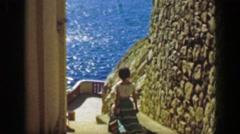 1952: Woman descending staircase La Quebrada Cliff Divers El Mirador Hotel. Stock Footage