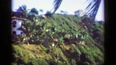 1952: Wealthy villa houses in tropical setting mountain cliff overlooks. Stock Footage