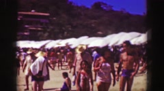 1952: Crowded beach people walking enjoying sunshine tropical vacation. Stock Footage