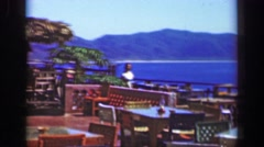 1952: Women strolling ocean view cliffside restaurant during off hours. Stock Footage