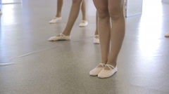 Ballerinas stand on floor which is covered with linoleum Stock Footage